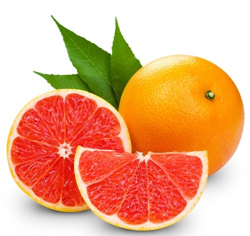 Grapefruit with slice detail on white background
