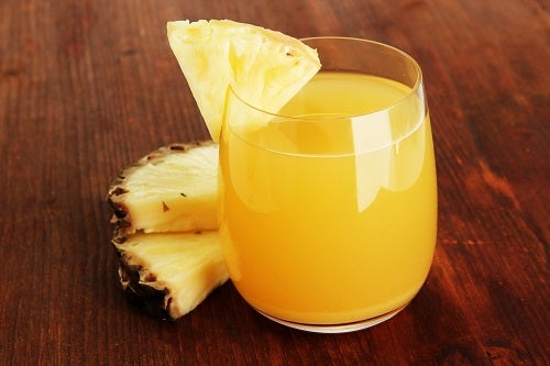 Delicious pineapple juice on table close-up