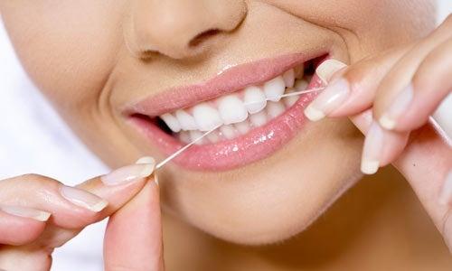 Importância do fio dental para o sorriso