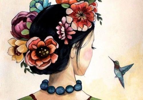Mulher desfrutando da vida olhando para um beija flor
