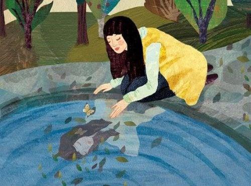 Mulher vendo sua imagem de verdade refletida em um lago