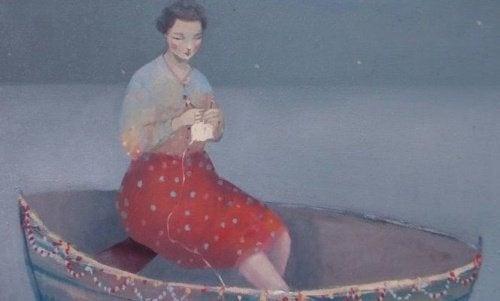 Mulher em barco aprendendo a ser forte