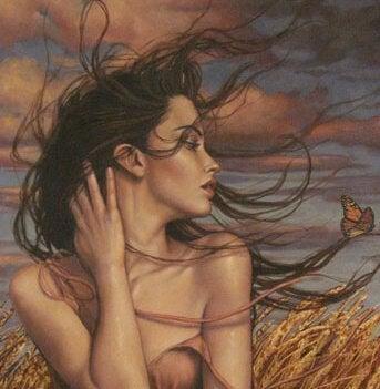 Mulher com os cabelos ao vento pensando em seu relacionamento