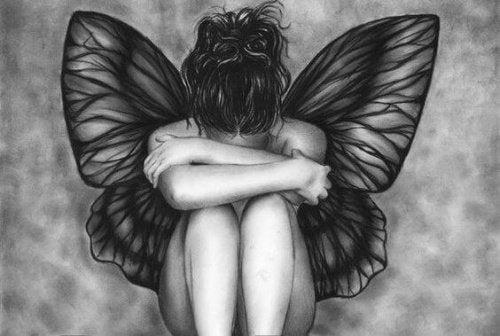 Mulher com asas deprimida
