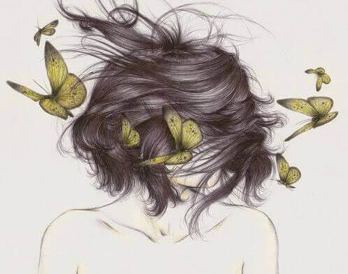 mulher-com-borboletas-pensando-no-que-precisa-deixar-ir