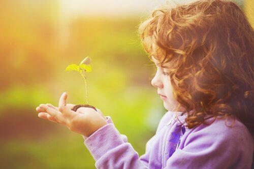 criança-com-planta-dando-asas-imaginação
