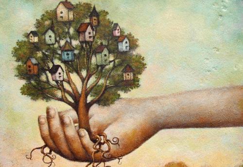 mão segurando uma árvore