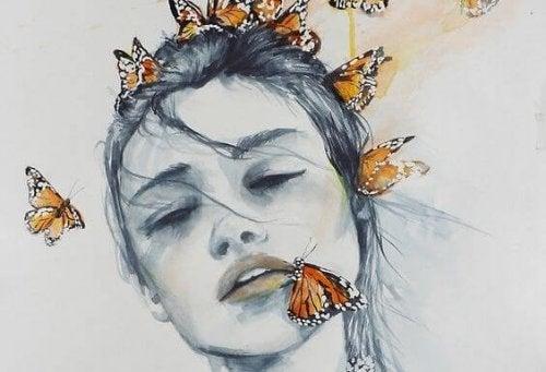 Mulher fazendo luto com borboletas