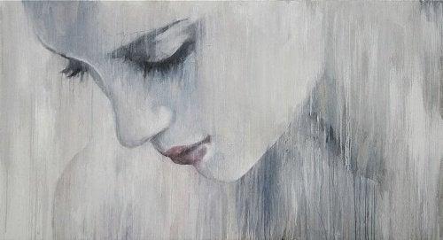 mulher_triste_olhando_para_baixo