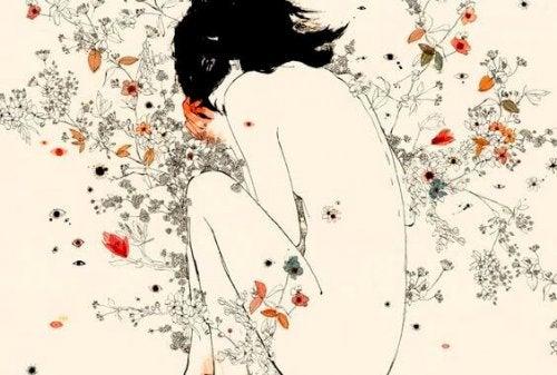 Mulher envolta em flores