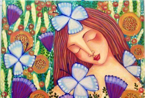 Mulher feliz com borboletas aplicando a abundância