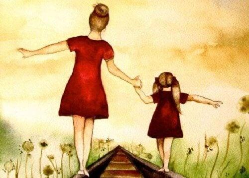 Mãe com filha sobre trilho do trêm