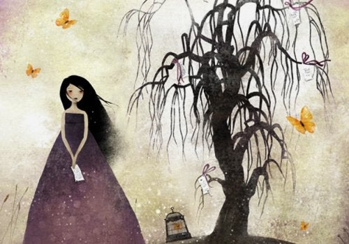 Mulher passando o tempo perto de uma árvore