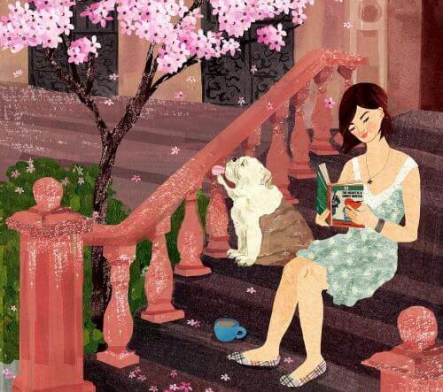 Mulher lendo livro com seu cachorro