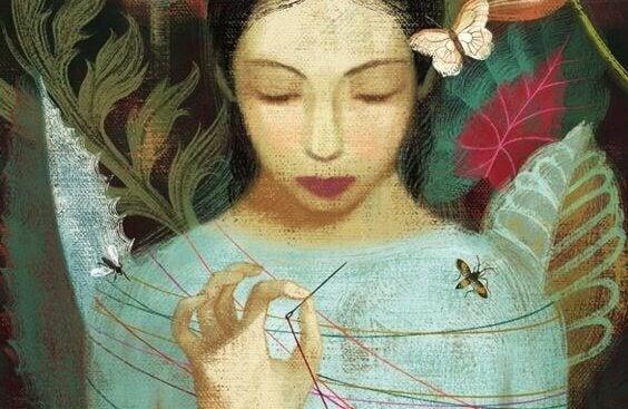 Mulher segurando agulha e fio