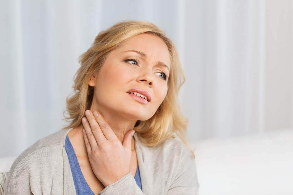 Mulher com problema na tireoide