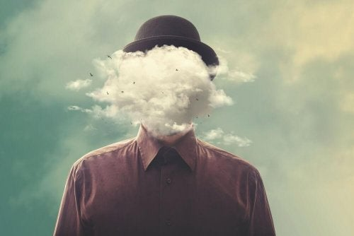 Homem escondendo as emoñóes com nuvem