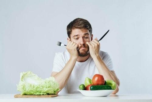Homem sem vontade de comer vegetais