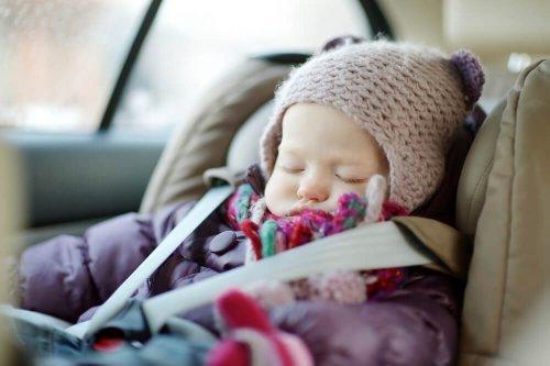 Bebê dormindo no Bebê Conforto